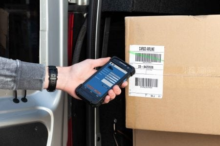 H-28 Android Mobile Computer used to scan barcodes on a box in a van